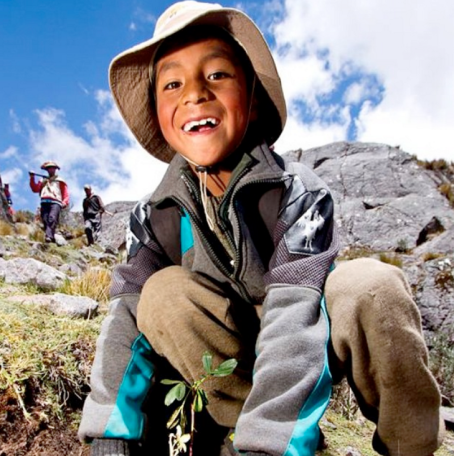 Boy planting trees in the Southern Andes.
